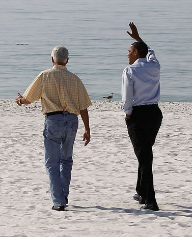 President Obama and Florida Gov. Charlie Crist walk along Casino Beach on Pensacola Beach, Fla.,Tuesday, June 15, 2010, as they visited the Gulf Coast region affected by the BP Deepwater Horizon oil spill. (AP Photo/Charles Dharapak)