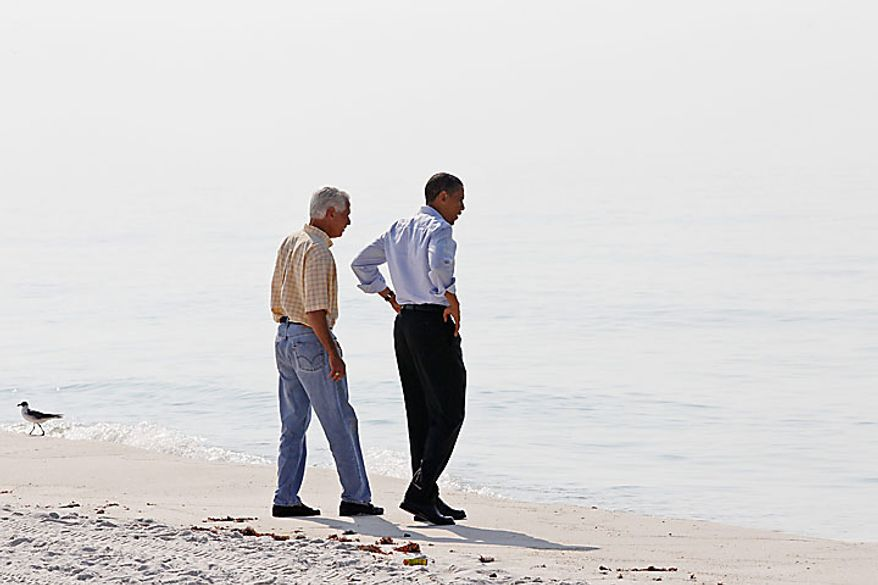 President Obama and Florida Gov. Charlie Crist walk along Casino Beach on Pensacola Beach, Fla., Tuesday, June 15, 20010, as they visited the Gulf Coast region affected by the BP Deepwater Horizon oil spill. (AP Photo/Charles Dharapak)