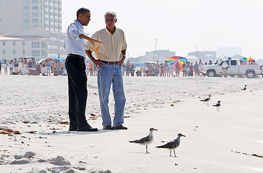 President Obama and Florida Gov. Charlie Crist walk along Casino Beach on Pensacola Beach, Fla., Tuesday, June 15, 2010, as he visited the Gulf Coast region affected by the BP Deepwater Horizon oil spill. (AP Photo/Charles Dharapak)