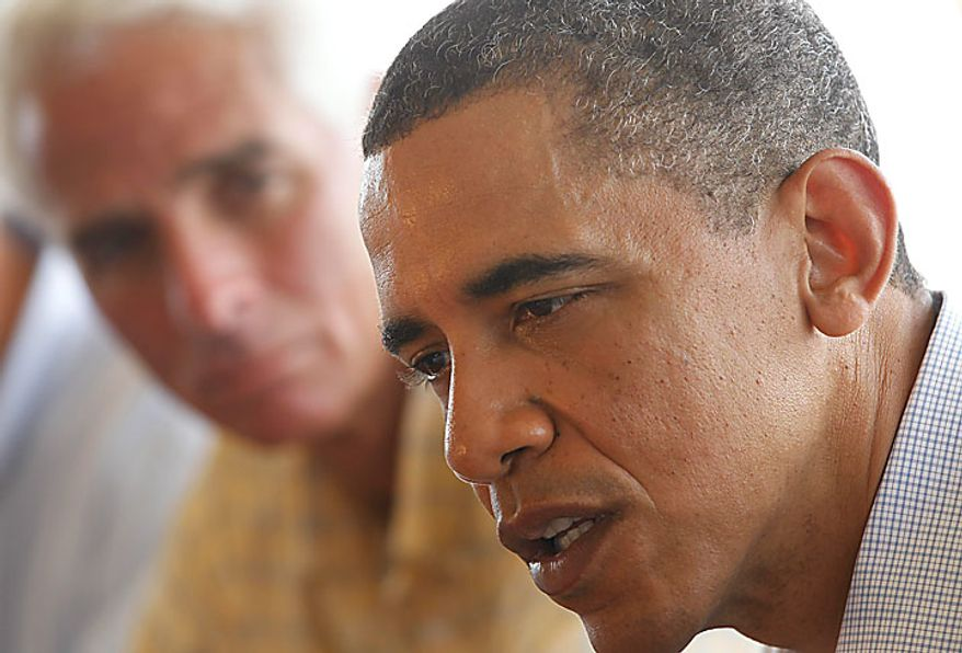 President Obama, accompanied by Florida Gov. Charlie Crist, left, makes a statement after he meets with local officials on Pensacola Beach, Fla., Tuesday, June 15, 2010, as they visited the Gulf Coast region affected by the BP Deepwater Horizon oil spill. (AP Photo/Charles Dharapak)