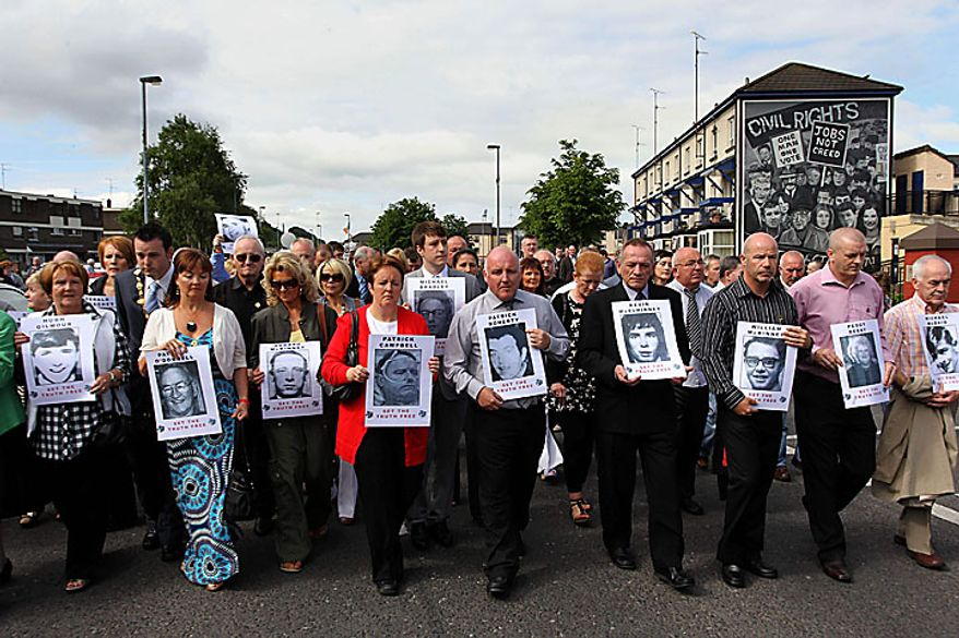 Relatives of those killed and injured in the 1972 Bloody Sunday shootings make their way to the Guildhall to receive a preview of the Saville Report in Londonderry, Northern Ireland on Tuesday, June 15, 2010. The British government is publishing the findings into investigation into Bloody Sunday, the 1972 killing of 13 Catholic demonstrators by British troops. The investigation began in 1998 and became the most expensive in British legal history as it gathered evidence from 2,500 witnesses, including troops who opened fire that day. (AP Photo/Peter Morrison)