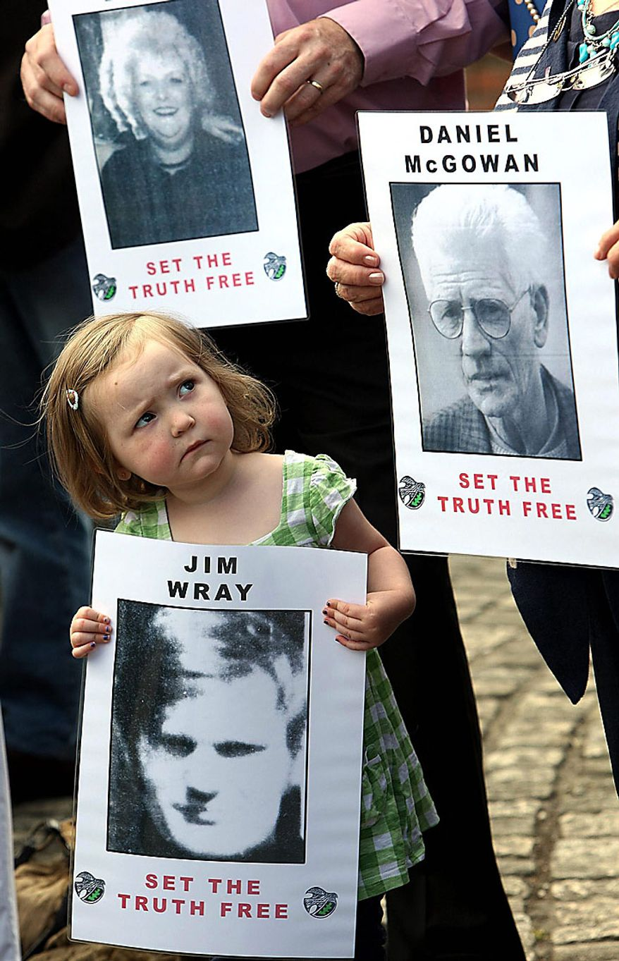Megan Bradley, 3, great-niece of Jim Wray, gathers in Londonderry, Northern Ireland, on Tuesday, June 15, 2010, with other relatives of those shot dead on Bloody Sunday in 1972. The British government is releasing the long-awaited Saville Report, which investigated Bloody Sunday, on which 13 Catholic demonstrators were killed by British troops. The investigation began in 1998 and became the most expensive in British legal history as it gathered evidence from 2,500 witnesses, including troops who opened fire that day. (AP Photo/Paul Faith/PA Wire)