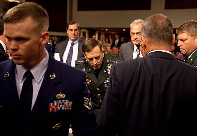 Army Gen. David Petraeus, U.S. Central commander, rises out of his chair after appearing to collapse on Capitol Hill in Washington on Tuesday, June 15, 2010, while appearing before the Senate Armed Services Committee. (AP Photo/Evan Vucci)