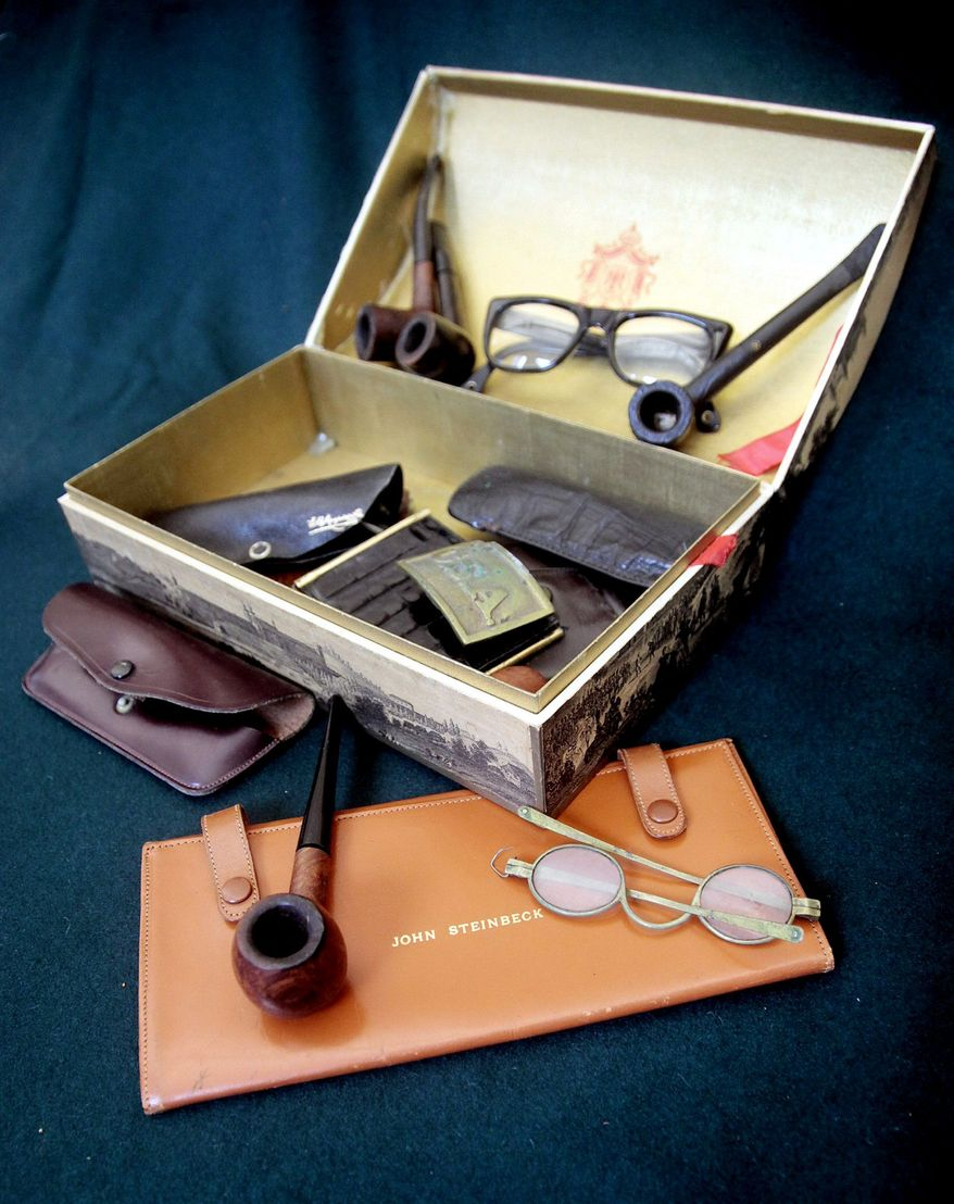 A case containing Steinbeck's glasses and pipes is on display at Bloomsbury Auctions in New York, where they will be put up for bid. The collection from his estate is expected to bring a total of $200,000 to $250,000.