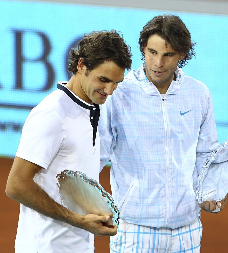 ** FILE ** In this May 16, 2010, file photo, Rafael Nadal, right, and Roger Federer, left, talk during the podium ceremony of the Madrid Open tennis tournament final in Madrid. Nadal won 6-4, 7-6. (AP Photo/Angel Navarrete)