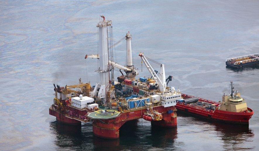 ** FILE ** Vessels operate near the Q4000 drilling rig at the site of the Deepwater Horizon well in the Gulf of Mexico on Sunday, June 13, 2010. (AP Photo/Dave Martin)
