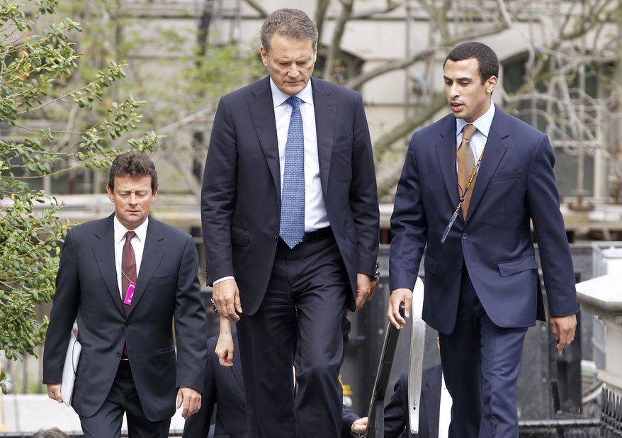 BP Chairman Carl-Henric Svanberg, center, walks with Nicholas Colvin, staff assistant in the White House Counsel's office, right, as BP CEO Tony Hayward follows at left as they arrive at the White House in Washington, Wednesday, June 16, 2010, for a meeting President Obama. (AP Photo/Charles Dharapak)