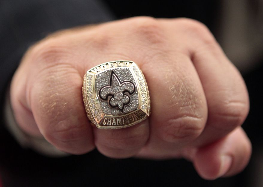 New Orleans Saints fullback Heath Evans displays his Super Bowl championship ring in New Orleans on Wednesday, June 16, 2010. The Saints defeated the Indianapolis Colts 31-17 in Super Bowl XLIV to attain the team's first championship in franchise history. (AP Photo)