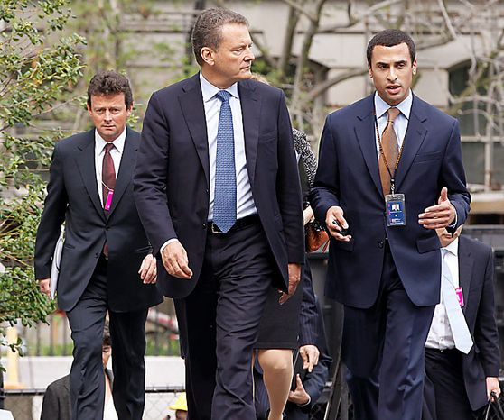 BP Chairman Carl-Henric Svanberg (center) walks with Nicholas Colvin, staff assistant in the White House counsel's office, as BP CEO Tony Hayward (left) follows as they arrive at the White House in Washin