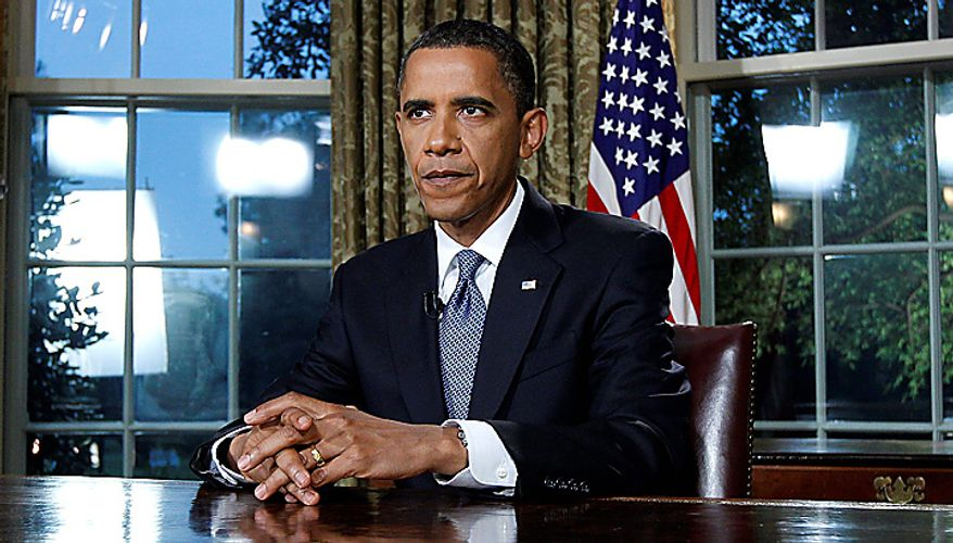 """President Obama is pictured after delivering a televised address from the Oval Office of the White House in Washington on Tuesday June 15, 2010. Mr. Obama said the nation will continue to fight the oil spill in the Gulf of Mexico for """"as long as it takes."""" (AP Photo/Alex Brandon)"""