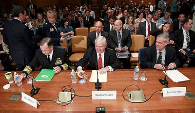 From left, Joint Chiefs Chairman Adm. Mike Mullen, Defense Robert Gates and Pentagon Comptroller Robert Hale, testify on Capitol Hill in Washington, Wednesday, June 16, 2010, before the Senate Appropriations Committee hearing on the Defense Department's fiscal 2011 budget. (AP Photo/Pablo Martinez Monsivais)