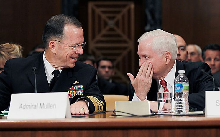 Joint Chiefs Chairman Adm. Mike Mullen, left, huddles with Defense Secretary Robert Gates on Capitol Hill in Washington, Wednesday, June 16, 2010, during the Senate Appropriations Committee on hearing on the Defense Department's fiscal 2011 budget. (AP Photo/Pablo Martinez Monsivais)