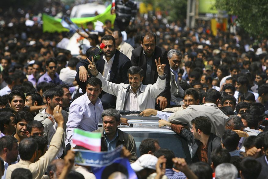 Escorted by his bodyguards, Iranian President Mahmoud Ahmadinejad, center, flashes the victory sign to supporters as he arrives in the city of Shahr-e-Kord, 325 miles south of the capital Tehran during a provincial tour, Wednesday, June 16, 2010. Iran's president says Tehran supports a dialogue with the outside world but that world powers must first be punished for the latest round of U.N. sanctions imposed on Iran.(AP Photo/ISNA, Amir Kholousi)