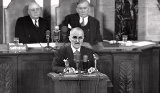 In this Jan. 8, 1951, file photo, President Harry S. Truman delivers his State of the Union speech before a joint session of Congress in Washington, D.C. The Harry S. Truman Library and Museum is hosting the release Wednesday, June 16, 2010, of the largest amount of intelligence documents on the Korean War, which began 60 years ago. The release includes more than 1,300 documents on intelligence from 1947 to 1954. More than half of the documents have never been made public, or are being re-released with new information. (AP Photo/File)