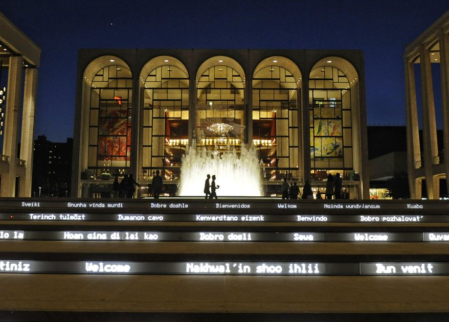 ** FILE ** In this file photo of Thursday, May 20, 2010, the Metropolitan Opera House, center, is seen behind a newly rebuilt fountain at Lincoln Center for the Performing Arts in New York. The Metropolitan Opera suffered through an ignoble fiscal year in 2009. (AP Photo/Henny Ray Abrams, file)