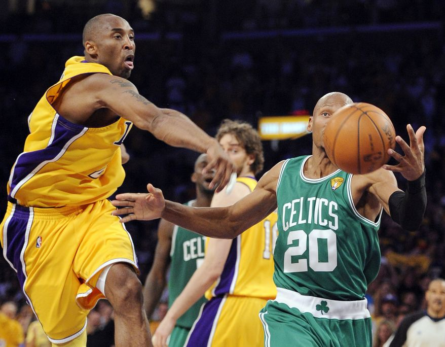 ASSOCIATED PRESS Los Angeles Lakers guard Kobe Bryant swats the ball away from Boston Celtics  guard Ray Allen during the first half of Game 7 of the NBA basketball finals Thursday, June 17, 2010, in Los Angeles.