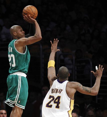 Boston Celtics guard Ray Allen shoots as Los Angeles Lakers guard Kobe Bryant defends during the first half of Game 2 of the NBA basketball finals on Sunday, June 6, 2010, in Los Angeles. (AP Photo/Chris Carlson)