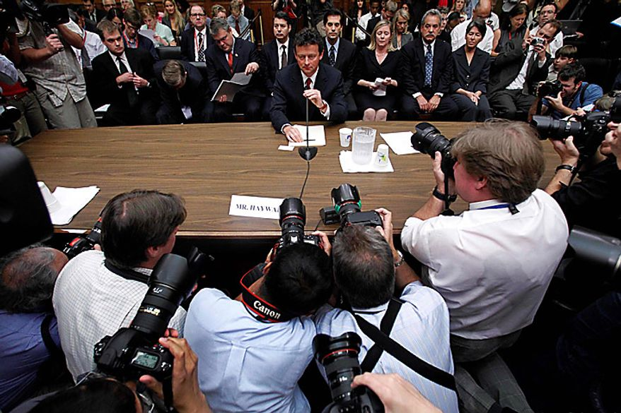 BP CEO Tony Hayward takes his seat on Capitol Hill in Washington on Thursday, June 17, 2010, before testifying before the House Oversight and Investigations subcommittee on the role of BP in the Deepwater Horizon explosion and oil spill. (AP Photo/Haraz N. Ghanbari)