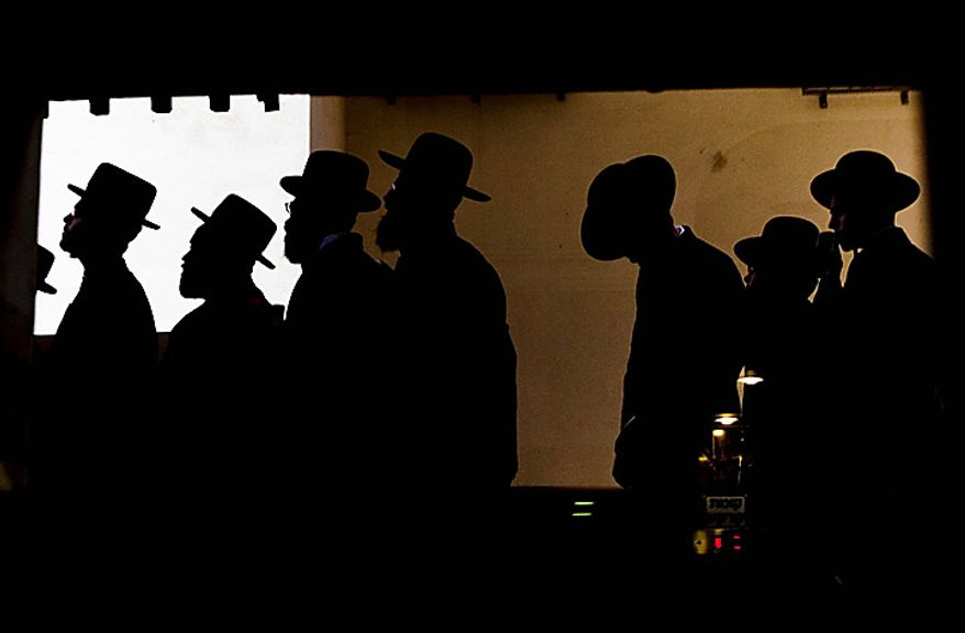 Ultra-Orthodox Jewish men gather in Bnei Brak, Israel, on Thursday, June 17, 2010, during a demonstration to protest an Israeli Supreme Court ruling forcing the integration of a religious girls school. Tens of thousands of black-clad men staged mass demonstrations on Thursday in Beni Brak and Jerusalem. (AP Photo/Ariel Schalit)