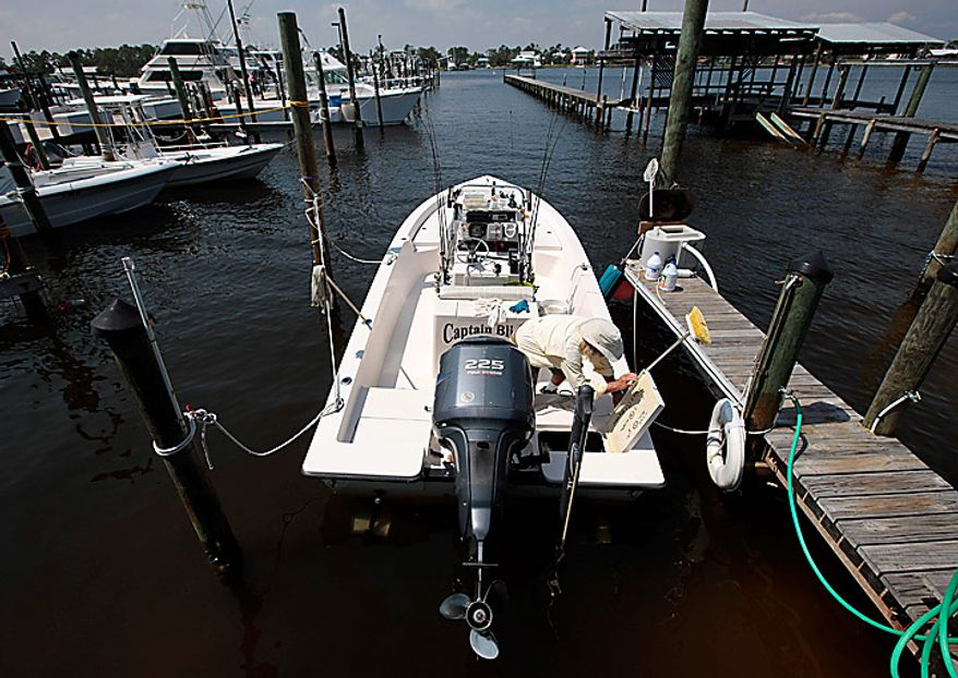 """Boat captain Brent """"Hollywood"""" Shaver works on his boat at Cotton Bayou in Orange Beach, Ala., Wednesday, June 9, 2010.  Shaver, a long time charter boat operator, is shutting down his inshore fishing business because of the gulf oil spill. (AP Photo/Dave Martin)"""