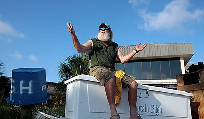"Boat captain Brent ""Hollywood"" Shaver sits on the dock at Cotton Bayou in Orange Beach, Ala., Thursday, June 10, 2010.  Shaver, a long time charter boat operator, is shutting down his inshore fishing business because of the gulf oil spill. (AP Photo/Dave Martin)"