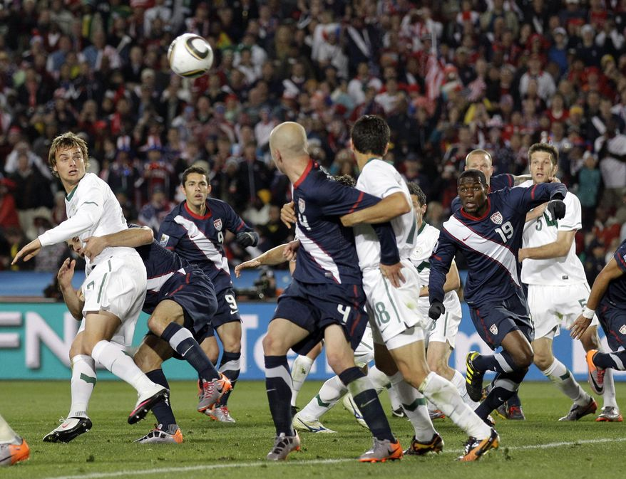 Players watch the ball heading into the net for a goal by United States' Maurice Edu, second right, that was later disallowed during the World Cup group C soccer match between Slovenia and the United States at Ellis Park Stadium in Johannesburg, South Africa, Friday, June 18, 2010. (AP Photo/Luca Bruno)