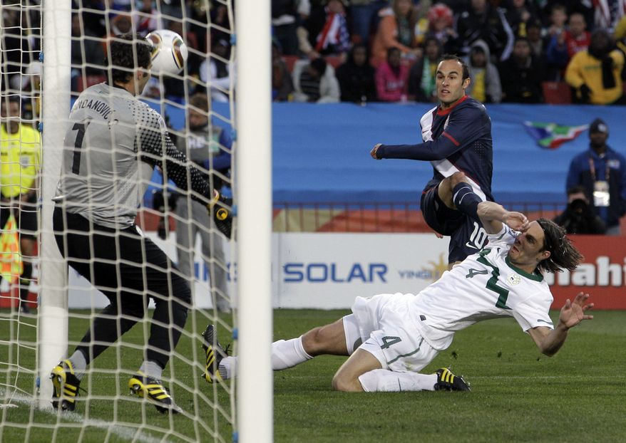 United States' Landon Donovan, right back, scores during the World Cup group C soccer match between Slovenia and the United States at Ellis Park Stadium in Johannesburg, South Africa, Friday, June 18, 2010. (AP Photo/Elise Amendola)