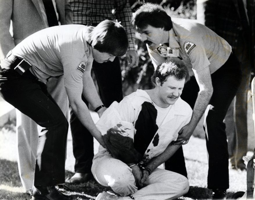 In this April 1985 picture, Ronnie Lee Gardner is restrained on the lawn at the Metropolitan Hall of Justice in Salt Lake City after the courthouse shooting death of attorney Michael Burdell during Gardner's failed escape attempt. Ronnie Lee Gardner was executed by firing squad at midnight on June 18, 2010. (AP Photo/Deseret News, O. Wallace Kasteler)