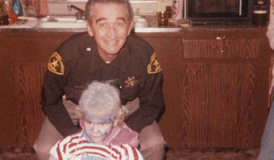 "This October 1984 picture provided by Tami Stewart shows George ""Nick"" Kirk and his granddaughter Jamie Stewart at Halloween. Kirk was a bailiff who was shot and wounded in Ronnie Lee Gardner's escape attempt in 1985. Kirk suffered chronic health problems until his death in 1995. Gardner was executed by firing squad at midnight on June 18, 2010. (AP Photo/Tami Stewart)"