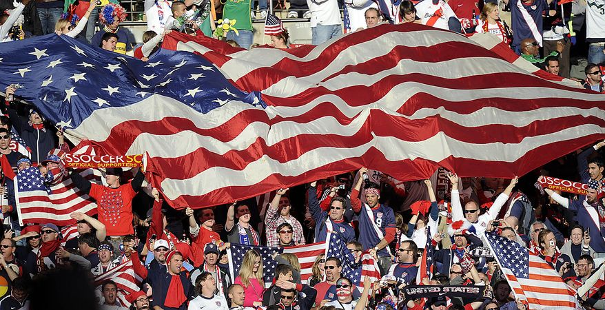 Fans wave the U.S. flag during the World Cup group C soccer match between Slovenia and the United States at Ellis Park Stadium in Johannesburg, South Africa, Friday, June 18, 2010.  (AP Photo/Martin Meissner)
