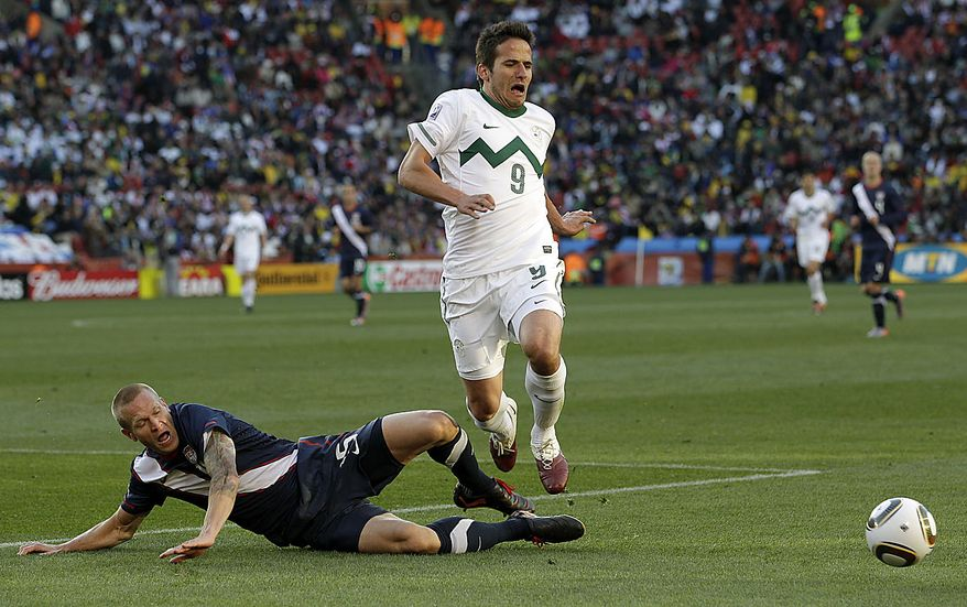 Slovenia's Zlatan Ljubijankic is tackled by United States' Jay DeMerit during the World Cup group C soccer match between Slovenia and the United States at Ellis Park Stadium in Johannesburg, South Africa, Friday, June 18, 2010.  (AP Photo/Elise Amendola)