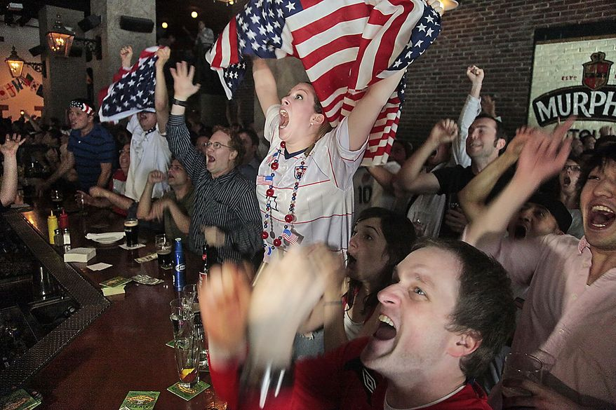 United States soccer fans react after the U.S. scored their second goal against Slovenia as they watch a live broadcast of the World Cup game at Stout's bar in New York on Friday, June 18, 2010. In a furious second-half comeback, the United States tied 2-2  against Slovenia, keeping alive the Americans' chances of advancing in the World Cup. (Photo/Bebeto Matthews)