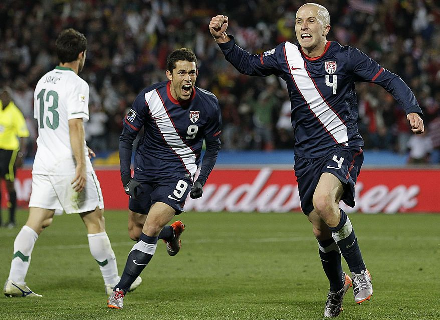 United States' Michael Bradley, right, celebrates with fellow team member Herculez Gomez, center, after scoring a goal during the World Cup group C soccer match between Slovenia and the United States at Ellis Park Stadium in Johannesburg, South Africa, Friday, June 18, 2010.  (AP Photo/Luca Bruno)