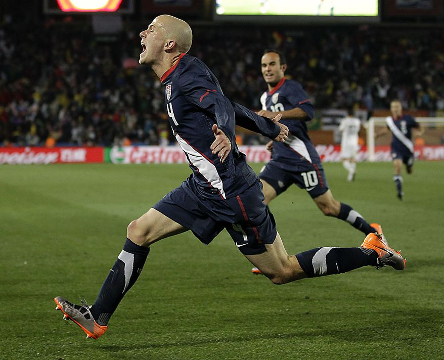 United States' Michael Bradley, foreground, celebrates next to United States' Landon Donovan, back, after scoring a goal during the World Cup group C soccer match between Slovenia and the United States at Ellis Park Stadium in Johannesburg, South Africa, Friday, June 18, 2010. The match ended in a 2-2 draw. (AP Photo/Luca Bruno)