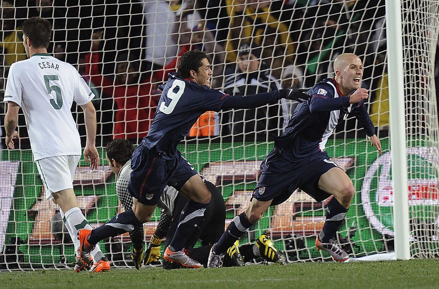 United States' Michael Bradley, right, celebrates with teammate United States' Herculez Gomez after scoring during the World Cup group C soccer match between Slovenia and the United States at Ellis Park Stadium in Johannesburg, South Africa, Friday, June 18, 2010. (AP Photo/Martin Meissner)