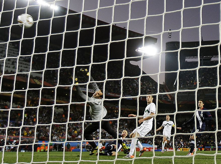 United States' Michael Bradley, second from left in back, scores a goal against Slovenia goalkeeper Samir Handanovic, foreground left, during the World Cup group C soccer match between Slovenia and the United States at Ellis Park Stadium in Johannesburg, South Africa, Friday, June 18, 2010.  (AP Photo/Elise Amendola)