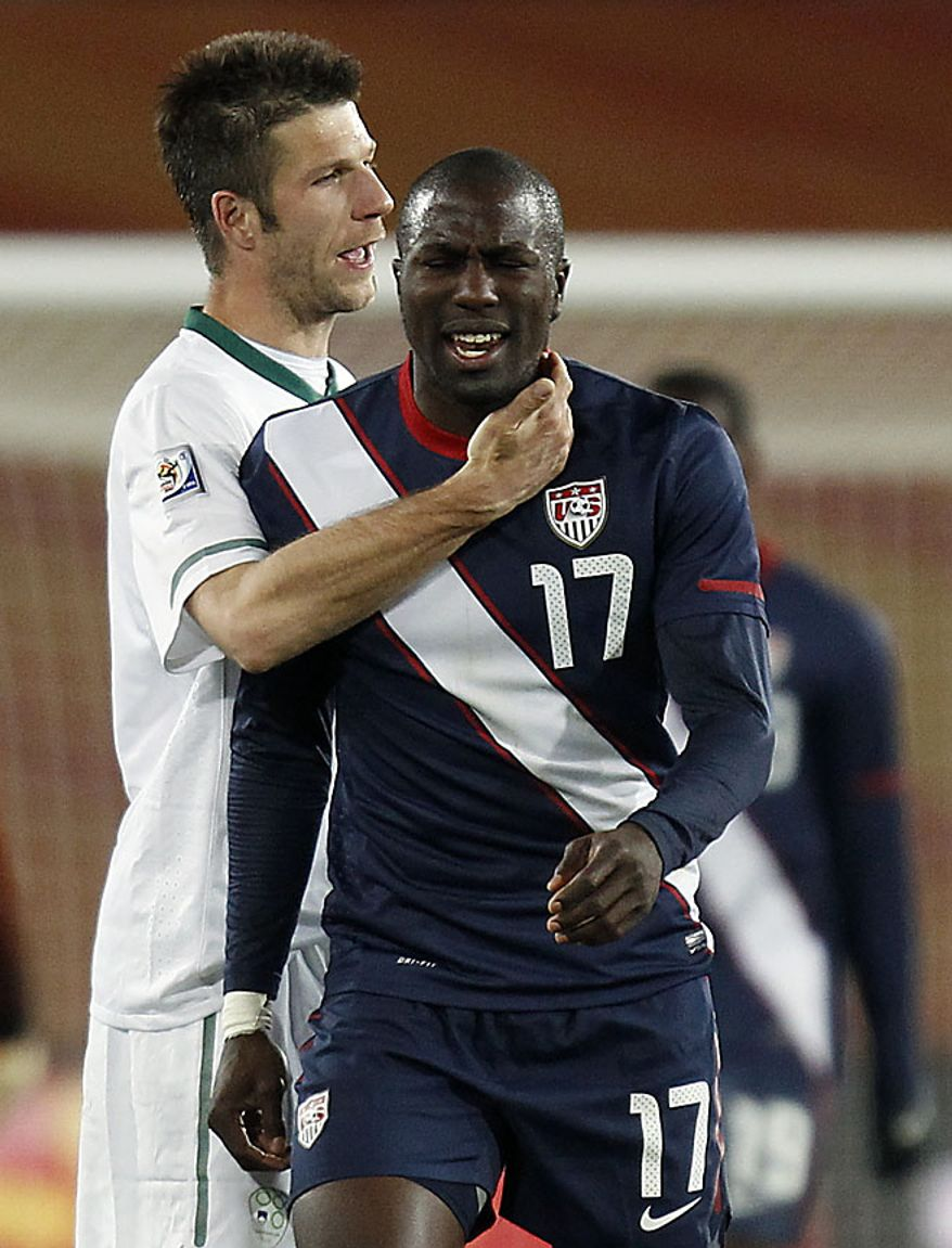 Slovenia's Bostjan Cesar, left, and United States' Jozy Altidore, right, walk off the pitch at the end of the World Cup group C soccer match between Slovenia and the United States at Ellis Park Stadium in Johannesburg, South Africa, Friday, June 18, 2010. The match ended in a 2-2 draw. (AP Photo/Luca Bruno)