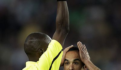 United States' Landon Donovan protests as Mali's referee Koman Coulibaly shows a yellow card and not a red card to a Slovenian player during the World Cup group C soccer match between Slovenia and the United States at Ellis Park Stadium in Johannesburg, South Africa, Friday, June 18, 2010.  (AP Photo/Luca Bruno)