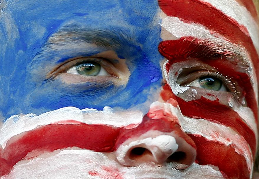A United States' fan looks on during the World Cup group C soccer match between Slovenia and the United States at Ellis Park Stadium in Johannesburg, South Africa, Friday, June 18, 2010.  (AP Photo/Hassan Ammar)