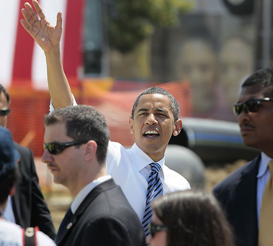 President Obama waves as he leaves after delivering remarks at the groundbreaking of a road project funded by the American Recovery and Reinvestment Act, Friday, June 18, 2010, in Columbus, Ohio. (AP Photo/Amy Sancetta)
