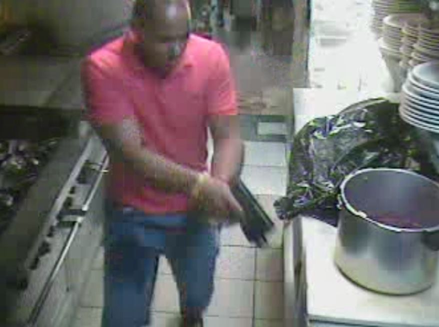In this image from video and released by the Hialeah police, Wednesday, June 9, 2010, Gerardo Regalado is seen with a hand gun inside the Yoyito Restaurant late Sunday, in Hialeah, Fla. Regalado on a shooting rampage at the restaurant Sunday that killed four women, including his wife, before he killed himself. (AP Photo/Hialeah Police)