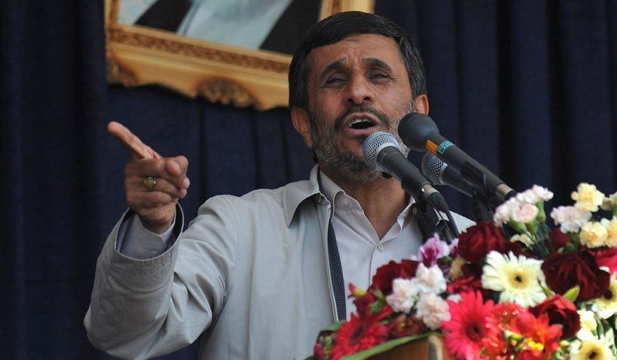 Iranian President Mahmoud Ahmadinejad speaks at a public gathering in Iran. He says Tehran is willing to deal with the outside world but resents U.N. sanctions. (Associated Press)