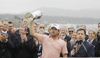 ASSOCIATED PRESS Graeme McDowell of Northern Ireland holds up the trophy after winning the U.S. Open golf tournament Sunday, June 20, 2010, at the Pebble Beach Golf Links in Pebble Beach, Calif.