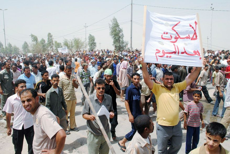 Iraqis protest power cuts in Nasiriyah, about 200 miles southeast of Baghdad, for a second day on Monday. Riot police in southern Iraq used water cannons to disperse protesters who were pelting them with stones. (Associated Press)
