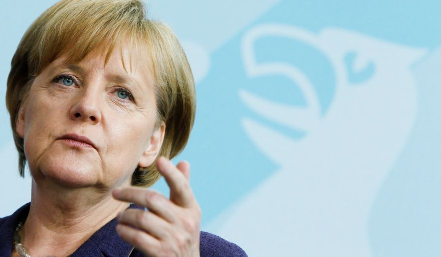 TEUTONIC TIP: German Chancellor Angela Merkel discusses global finance after a meeting with advisers at the Chancellery in Berlin on Monday ahead of the Group of 20 summit. (Associated Press)