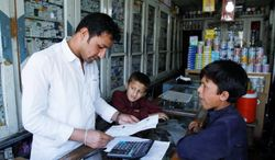 Mr. Khan works in his pharmacy in Jalalabad, east of Kabul. A pharmacist by trade, Mr. Khan is part of a small corps of Afghan actors and filmmakers who produce movies for DVD on shoestring budgets but who hope in time to project values to their young audiences beyond weapons and war. (Associated Press)