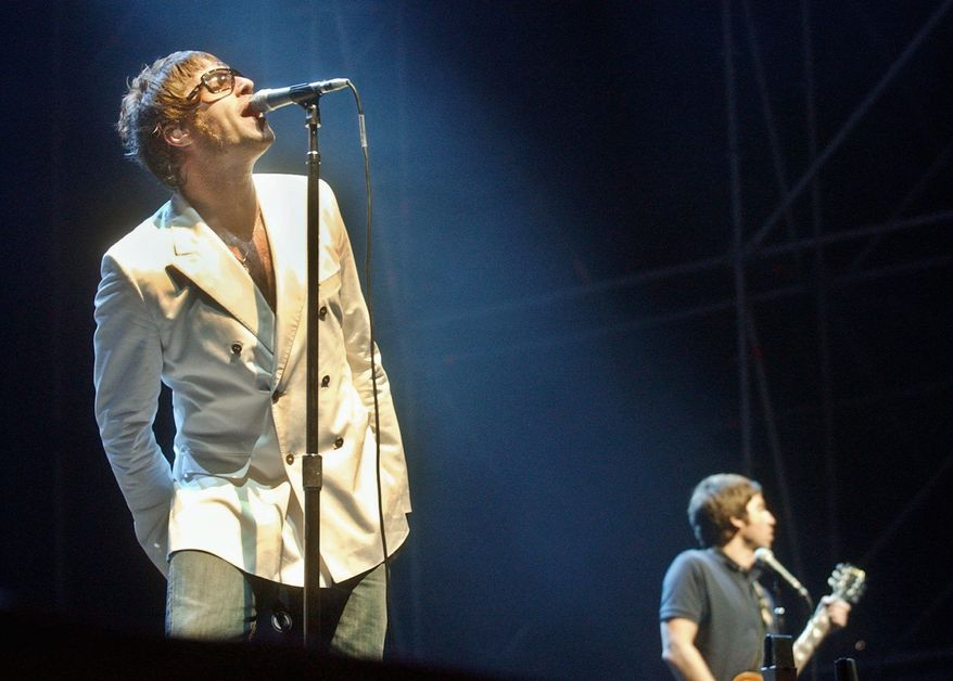 Liam (left) and Noel Gallagher of Oasis perform in 2006. (Associated Press)