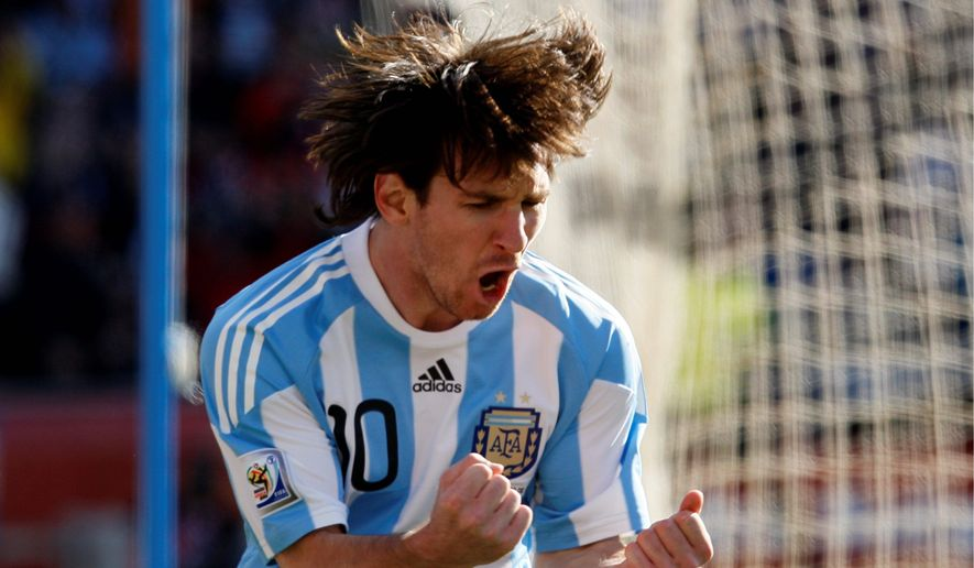 Argentine soccer player Lionel Messi wants to get Oasis back together for a victory concert if Argentina wins the World Cup. (Associated Press)