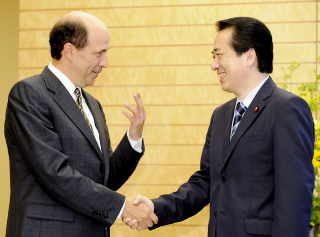 """John Roos (left), U.S. ambassador to Japan, shakes hands with Japanese Prime Minister Naoto Kan before their talks at Mr. Kan's office in Tokyo on Tuesday, June 22, 2010. On Monday, Mr. Kan said he will reassure President Obama when they meet at a summit this weekend that Japan-U.S. ties continue to be """"the cornerstone"""" of Japan's diplomacy. (AP Photo/Yoshikazu Tsuno, Pool)"""