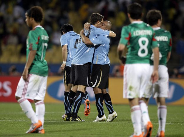ASSOCIATED PRESS Uruguay  players celebrate at the end of the World Cup group A soccer match between Mexico and Uruguay  at Royal Bafokeng Stadium in Rustenburg, South Africa, on Tuesday, June 22, 2010. Uruguay won 1-0.